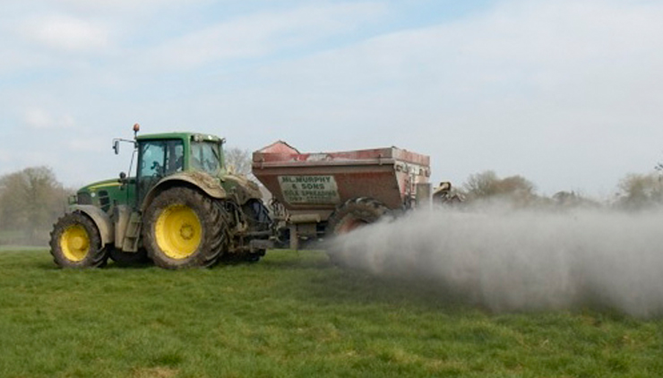 Tractor spreading agricultural lime