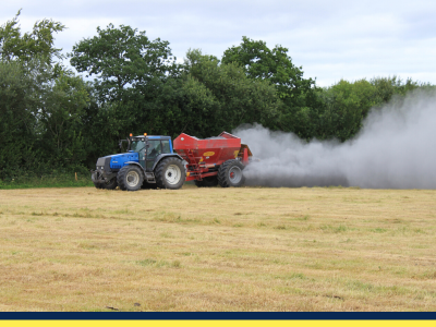 tractor spreading agri lime to silage ground