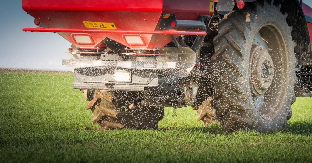 Fertiliser being spread onto grass