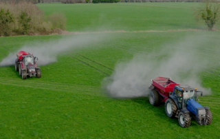 agri lime being spread to grassland